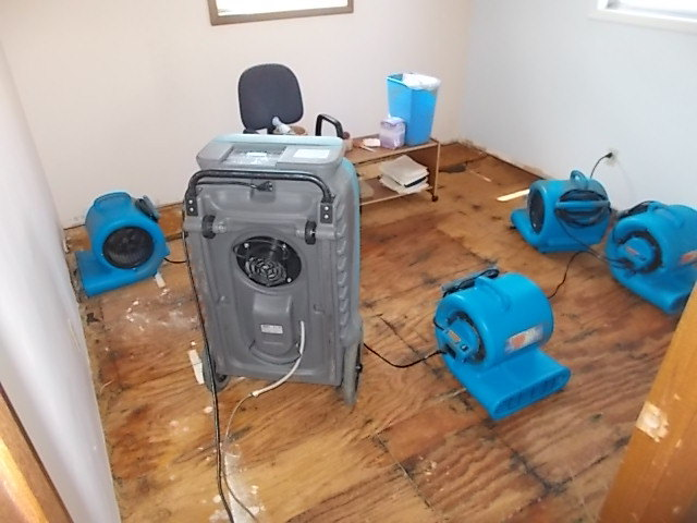 air blowers and dehumidifier drying water from floor