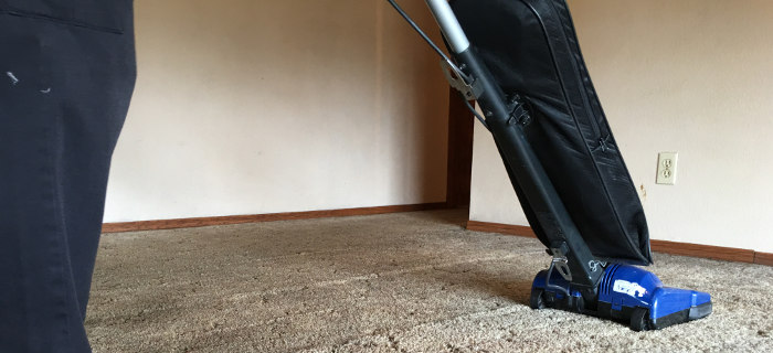 vacuuming carpets before cleaning