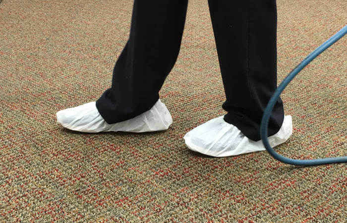 wearing shoe covers during carpet cleaning
