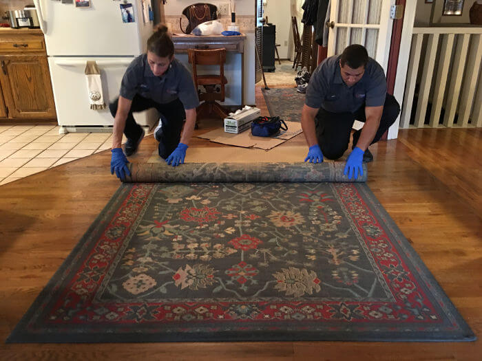 rolling up rug after fire
