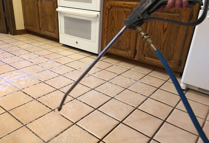 applying tile cleaning detergent on floor process 1