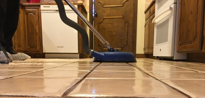 cleaning tile grout with hot water extraction floor cleaner process 4
