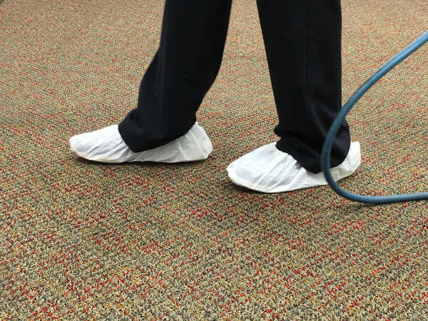 wearing shoe covers during carpet cleaning 2-17-17